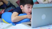 game : Asian boy playing with laptop