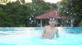 eğlendirmek : Slow motion of Young Asian boy having fun at pool, happy asian child playing in pool.