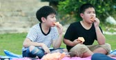 лосось : Happy asian boy eating snack food.