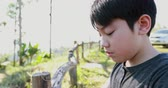 zneužívání : Asian boy crying in garden