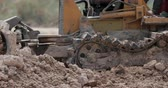 hoe : Unidentified worker control Bulldozer to excavator grader removing the ground Stock Footage