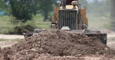 grader : Unidentified worker control Bulldozer to excavator grader removing the ground Stock Footage