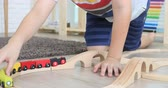 inşaat : Happy asian cute boy playing wood train toy at home .