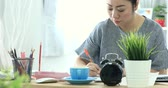 законопроект : 4K Portrait of Asian woman working hard about paying the bills
