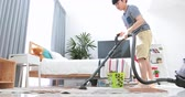 limpeza : Asian cute boy doing your hose housework, housekeeping, and household concept.