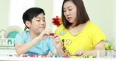 adorável : Happy asian family mother and son playing plastic block together . Stock Footage