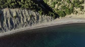 Aerial flight with drone DJI over beautiful green mountains and white sandy beach. 4k
