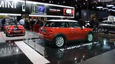 kompaktní : Red new Mini compact hatchback car on display at the 2014 Brussels motor show. People in the background are looking at the cars. Dostupné videozáznamy
