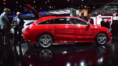shooting brake : Two men looking at the new Mercedes CLA Shooting Brake compact estate car on display at the 2015 Brussels Motor Show.