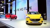 kompaktní : Yellow and red Opel Corsa Hatchback cars on display at the 2015 Brussels Motor Show.