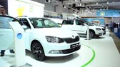 bruxelas : White Skoda Fabia Combi and Skoda Roomster at the 2015 Brussles motor show. A man is cleaning the car in the foreground.