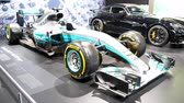 formül : Mercedes AMG F1 W08 EQ Power + Mercedes-Benz Formula One racing car participating in the 2017 F1 World Championship and winning both Drivers and Constructors Championships on display at the 2018 European Motor Show Brussels. Stok Video