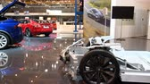 crossover : Tesla chassis and Tesla Model X crossover SUV and Model S liftback all-electric, luxury, cars during the 2018 European Motor Show Brussels.