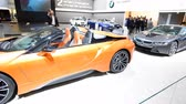 стенд : BMW i8 coupe and i8 Roadster plug-in hybrid luxury sports cars on display at the 2018 European motor show in Brussels.