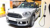 фронт : MINI Countryman Plug In Hybrid retro design crossover SUV car on display at the Mini Motorshow stand during the 2018 European Motor Show Brussels. Стоковые видеозаписи