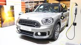 wtyczka : MINI Countryman Plug In Hybrid retro design crossover SUV car on display at the Mini Motorshow stand during the 2018 European Motor Show Brussels. Wideo