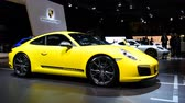 výrobce : Porsche 911 Carrera T sports car in bright yellow on display at the 2018 European motor show in Brussels.