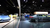 sala de exposição : Porsche 911 Turbo S coupe, 911 Turbo S Cabriolet and Panamera 4 E-Hybrid sports cars on display at the 2018 European motor show in Brussels.