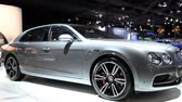 limousine : Bentley Flying Spur W12 luxury executive saloon car on display at the 2018 European motor show in Brussels. Stock Footage