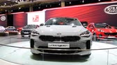 sala de exposição : Kia Stinger is a mid-sized executive 4-door fastback car on display at the 2018 European motor show in Brussels.