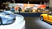 supercar : Ford GT Supercar and Ford Mustang performance car on display at the 2018 European motor show in Brussels. Stock Footage