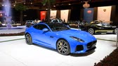 спортивный : Jaguar F-Type Supercharged Coupe sports car front view on display at the 2018 European motor show in Brussels. Стоковые видеозаписи
