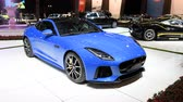 фронт : Jaguar F-Type Supercharged Coupe sports car front view on display at the 2018 European motor show in Brussels. Стоковые видеозаписи