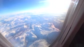 mid air : Aerial view over the snowy mountains of Northern Norway in the Arctic Circle during a beautiful winter day. Stock Footage