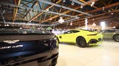 brüksel : Aston Martin Vantage in bright green and DB11 Convertible exclusive Grand Tourer sports cars on display at the 2018 European motor show in Brussels.