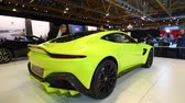 martin : Aston Martin Vantage in bright green exclusive Grand Tourer sports car on display at the 2018 European motor show in Brussels. Stock Footage
