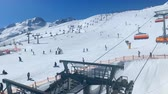 chairlift : Ski slopes and chairlift in the Tiroler Alps in the Sölden ski area in Austria during winter. Stock Footage