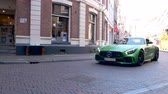 city lifestyle : Mercedes-AMG GT R sports car sports cars driving in a street in the city of Zwolle during a sunny summer morning.