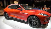 martin : BRUSSELS, BELGIUM - JANUARY 8: Aston Martin DBX mid-sized, front-engine, all-wheel drive luxury crossover SUV on display at Brussels Expo. Handheld gimbal shot around the car. Stock Footage
