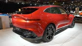 motor show : BRUSSELS, BELGIUM - JANUARY 8: Aston Martin DBX mid-sized, front-engine, all-wheel drive luxury crossover SUV on display at Brussels Expo. Handheld gimbal shot around the car. Stock Footage