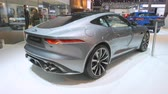 hospodářství : BRUSSELS, BELGIUM - JANUARY 9: Jaguar F-Type Coupe 2020 facelift sports car on display at Brussels Expo. Handheld gimbal shot at the rear of the car.