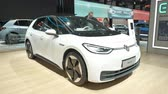 wtyczka : BRUSSELS, BELGIUM - JANUARY 9: Volkswagen ID.3 all electric hatchback car on display at Brussels Expo. Handheld gimbal shot around the car.