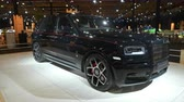 rolls royce : BRUSSELS, BELGIUM - JANUARY 8, 2020: Rolls-Royce Cullinan Black Badge luxury SUV car on display at Brussels Expo. Handheld gimbal shot.