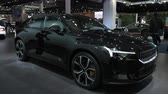 hybride : BRUSSELS, BELGIUM - JANUARY 9, 2020: Polestar 2 all-electric 5-door fastback car in black on display at Brussels Expo. Handheld gimbal shot around the car. Stockvideo
