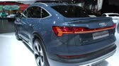 motor show : BRUSSELS, BELGIUM - JANUARY 9, 2020: Audi e-tron Sportback full electric luxury crossover SUV car on display at Brussels Expo. Handheld gimbal shot.