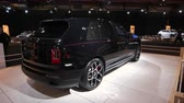 BRUSSELS, BELGIUM - JANUARY 8, 2020: Rolls-Royce Cullinan Black Badge luxury SUV car on display at Brussels Expo. Handheld gimbal shot.