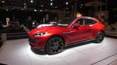 martin : BRUSSELS, BELGIUM - JANUARY 8, 2020: Aston Martin DBX mid-sized, front-engine, all-wheel drive luxury crossover SUV on display at Brussels Expo. Handheld gimbal shot around the car.
