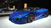 BRUSSELS, BELGIUM - JANUARY 8, 2020: Lamborghini Huracan EVO Spyder convertible sports car on display at Brussels Expo. Handheld gimbal shot. 무비클립