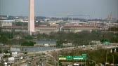 terrorist : Tilt up from traffic on I-395 to the Washington Monument