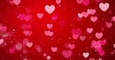 carmesim : Red hearts and confetti texture. Happy Valentines day background. Loop 4k Stock Footage