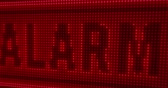 estado de alerta : Alarm word on big LED display with large pixels. Bright light warning texts on lamps stylized screen in seamless and loopable animation. Stock Footage