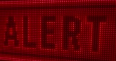 estado de alerta : Alert word on big LED display with large pixels. Bright light warning texts on lamps stylized screen in seamless and loopable animation. Stock Footage