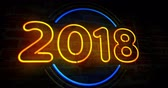 2019 year neon light on brick wall background. Glowing large numbers 3D abstract animation. Wideo