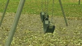 brinquedos : Empty childrens swings in playground