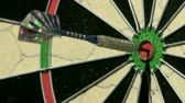 преуспевать : Single dart hits bullseye close up