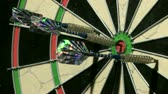 преуспевать : Close up of three darts including a bulls eye